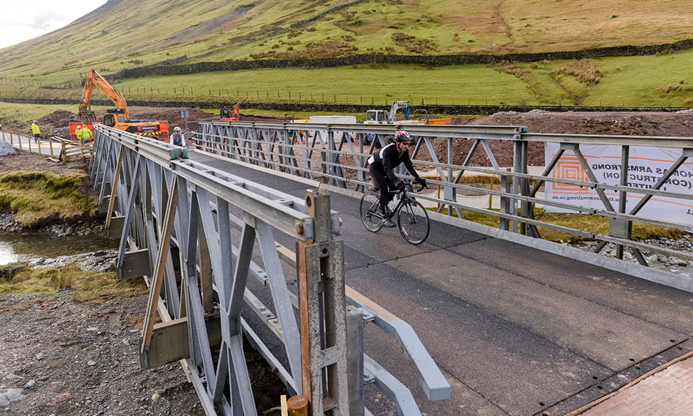 Cyclist on bridge at Thirlmere