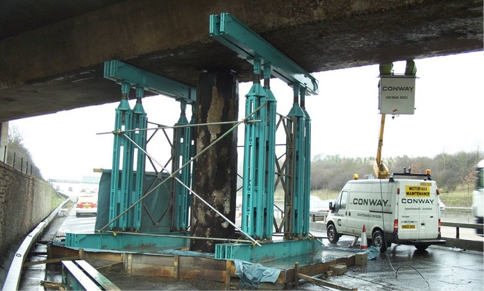Temporary propping lifting and supporting a busy motorway bridge from collapsing while construction work goes on to strengthen the bridge
